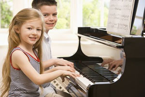 Kids Enjoying Playing Piano