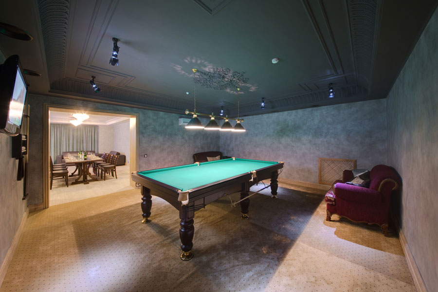 A fully restored pool table in a beautiful home
